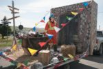 CFI employee Heather Clarke takes part in the St. Lawrence Day parade on a float made by CFI staff.