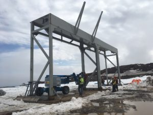 Doors are erected for the Mine Workshop. An inflatable structure will be attached to the doors for the main building portion.