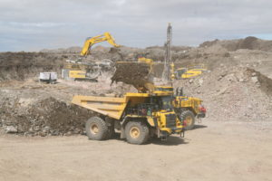 A Haul Truck waits for a rock load to remove from site.
