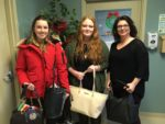 Jessica Squires (left) and Ashley Hodge (centre) present donations to Joan Coady-Kelly, representative for Grace Sparkes House in Marystown.