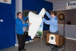 Lindsay Gorrill and Hubert Beck, President of the St. Lawrence Senior Men's Soccer Association, unveil the donation of the soccer score clock.