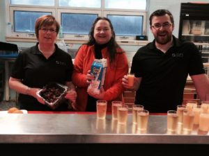 CFI employees Patricia Clarke (left) and Justin Haley (right) join Mary Clarke of Esteem Women Inc. (centre) for the St. Lawrence Academy Breakfast Program.