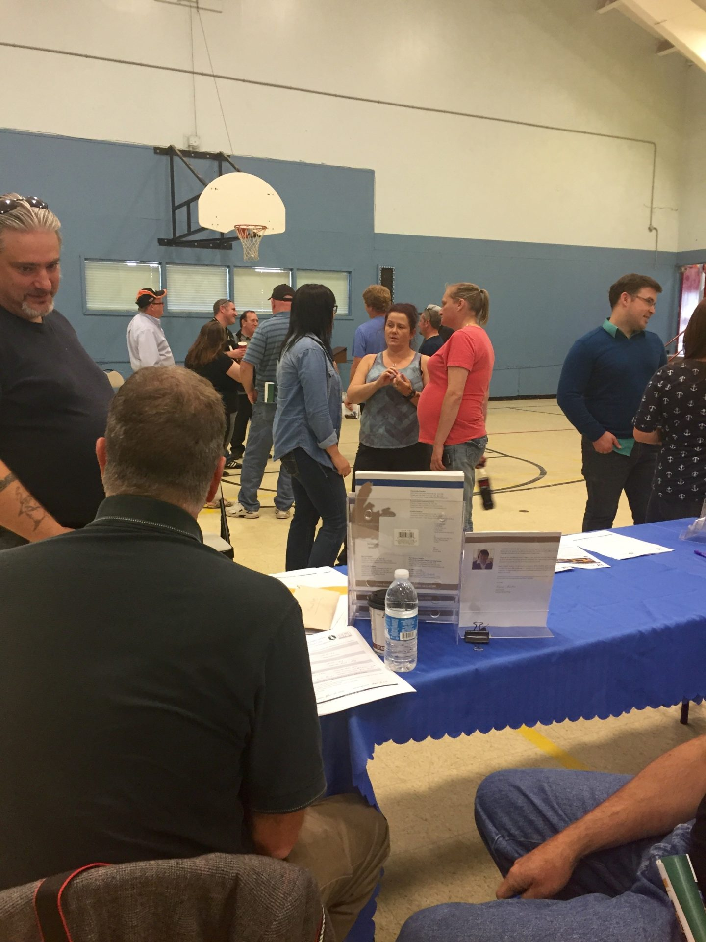 Open house attendees speak with CFI and Keyin college representatives about the Haul Truck Operator Program