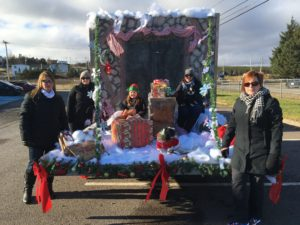 CFI staff and family participate in the Santa Claus Parade. (From l-r) Marsha Lake, Alysha Slaney, Marsha's Daughter Jade, Melissa Lambert (with her dog Jellybean) and Patricia Clarke (with her dog Lola.)